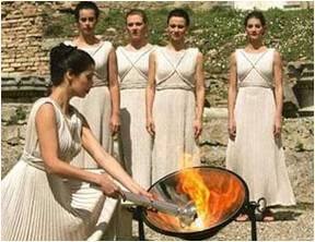 Young women lighting the Olympic flame
